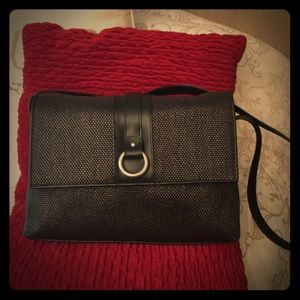 Black textured bag with red interior